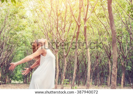 Freedom enjoy natural concept Young beautiful asian women stretch enjoying with fresh air in the forest look so happy - stock photo