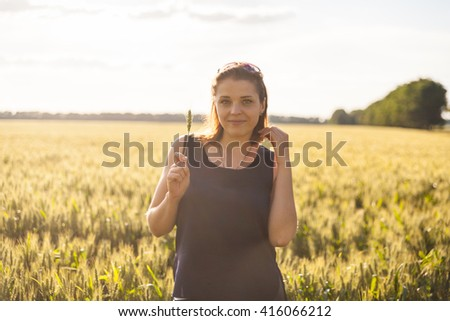 freedom, happiness, inspiration, a walk, a beautiful girl in a field holding wheat ears, wheat field, green wheat, summer, sunlight