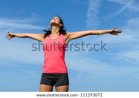 Freedom happy concept. Free woman raising arms to clear blue sky. Beautiful and joyful caucasian girl. - stock photo
