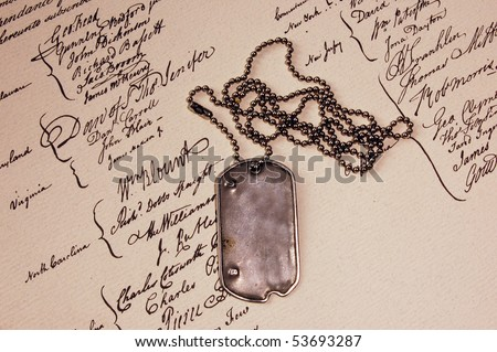 Freedom is not free . Dog tag on American Constitution. - stock photo