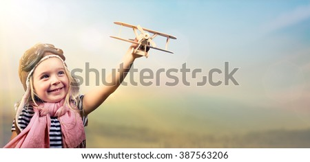 Freedom To Dream - Joyful Girl Playing With Airplane Against The Sky - Vintage Effect  - stock photo