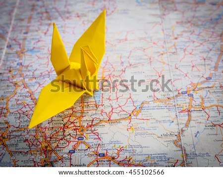 Freedom travel concept, origami crane on map city thailand background with copy space - stock photo