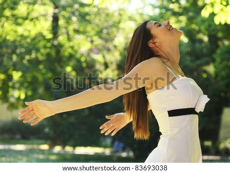 Freedom woman with arms open having fun and enjoying the nature - stock photo