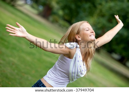 Freedom woman with opened arms outdoors smiling - stock photo