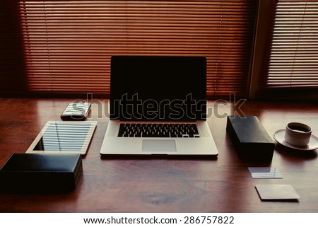 Freelancer needs workstation with accessories and cup of coffee, open laptop computer and digital tablet with blank copy space screen at wooden table in home, on-line learning or distance work concept - stock photo