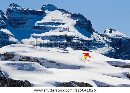 Freeride in fresh powder snow - man skiing downhill - stock photo