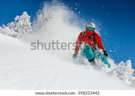 Freeride in fresh powder snow. Skiing. - stock photo