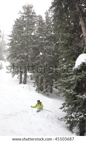 Freeride skier goes downhill in powder snow Mont Blanc Courmayeur Italy - stock photo