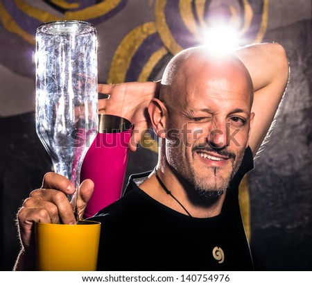 Freestyle American Bartender -  Two colored Shakers and Bottle - stock photo