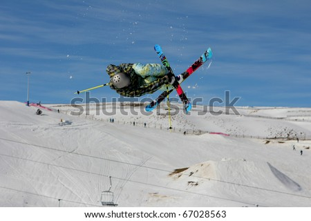 Freestyle skier in mid air jump - stock photo