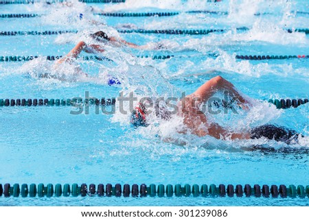 Freestyle swimmers racing - stock photo