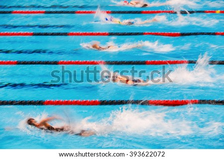 Freestyle swimming race, motion blurred image. - stock photo
