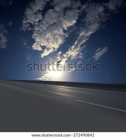 Freeway at sunset as background or texture - stock photo