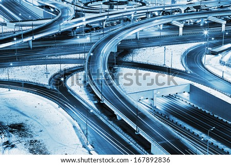 Freeway in night with cars light in modern city. Moscow in winter night. Russia - stock photo