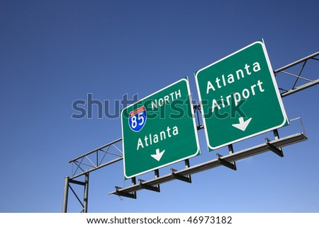 Freeway signs directing drivers to the Atlanta airport. Horizontal shot. - stock photo