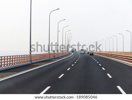Freeway with cars in white background