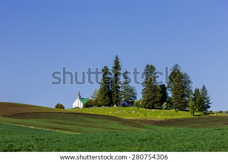 Freeze Church in the country near Potlach, Idaho nestled by farm fields of the Palouse. - stock photo