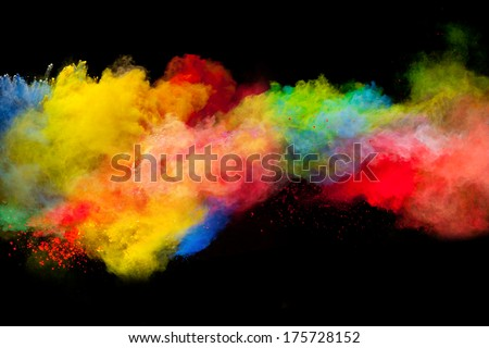Freeze motion of colored dust explosion isolated on black background - stock photo