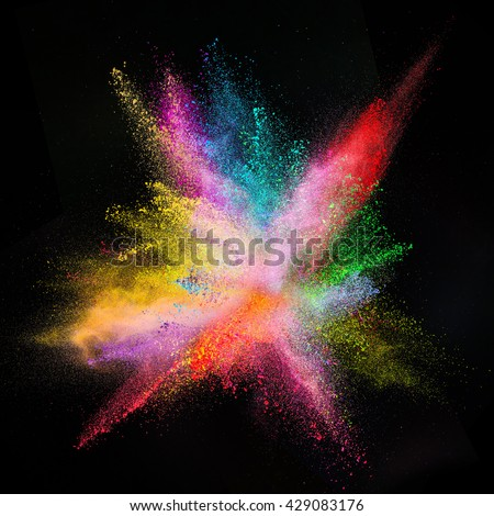 Freeze motion of colored dust explosion isolated on black background.