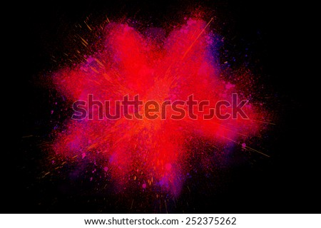 Freeze motion of colorful powder paint exploding isolated on black dark background. Abstract design of color dust cloud. Particles explosion screen saver, wallpaper, brush  - stock photo