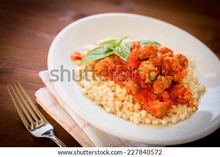 Fregola with tomato sauce and fresh sausage, sardinian pasta