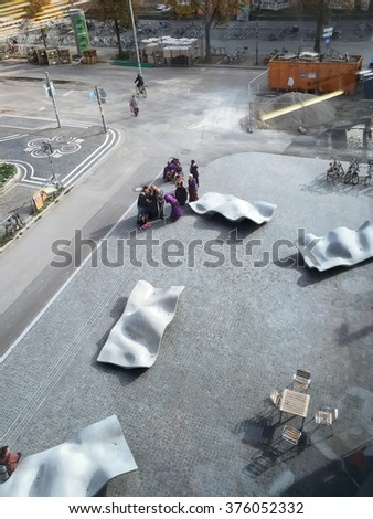 FREIBURG, GERMANY - OCTOBER, 2015: Images of the interior and surroundings of the newly built University Library in Freiburg, Germany in 10/15. Images show modern concrete architecture and people. - stock photo