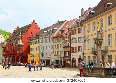 FREIBURG IM BREISGAU, GERMANY - MAY 5, 2013: Old buildings on Munsterplatz, the central square of Freiburg im Breisgau, Baden-Wurttemberg