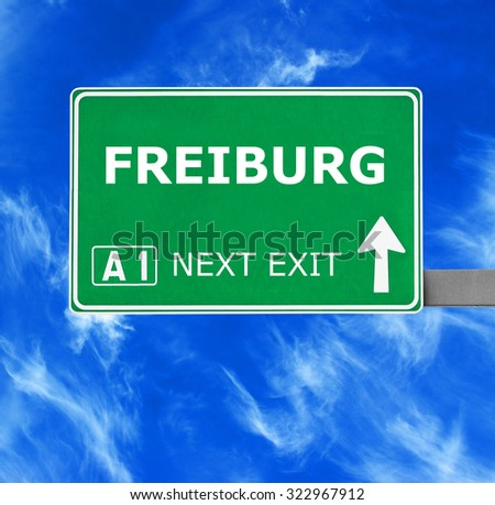 FREIBURGroad sign against clear blue sky