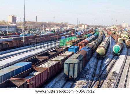 Freight cars in cargo port in the early spring - stock photo