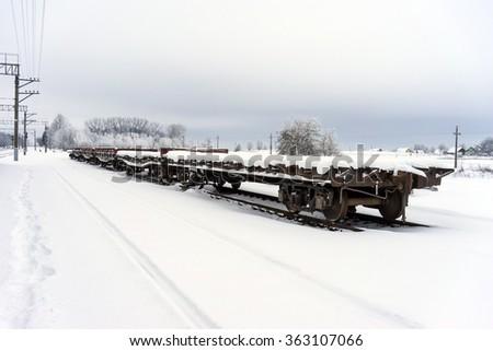 freight platform cars winter - stock photo