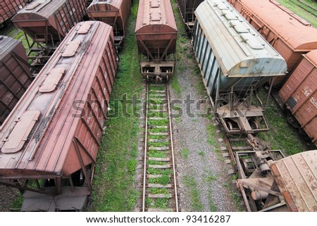 Freight Station with many old wagons of USSR on rails - stock photo