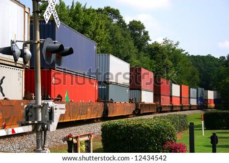 Freight Train across railroad crossing - stock photo
