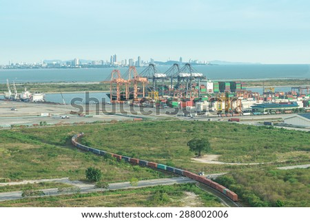 Freight train carrier container into port, Singapore - stock photo
