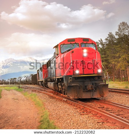 Freight train departs from Jasper station. Alberta. Canada.  - stock photo