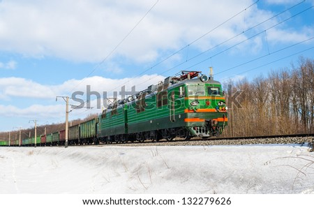 Freight train hauled by electric locomotive. Ukrainian railways - stock photo