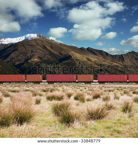 Freight Train in a Mountain Landscape - stock photo