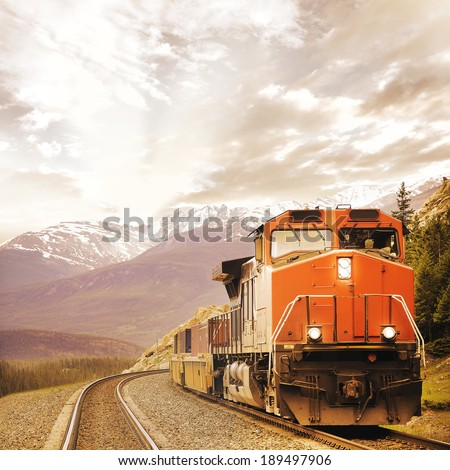 Freight train in Canadian rockies. - stock photo