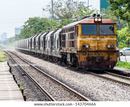 Freight train is moving pass the old station in city of Thailand. - stock photo