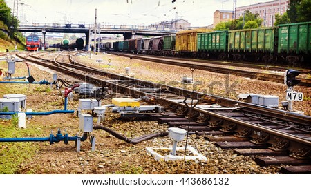 Freight train on railway track - stock photo