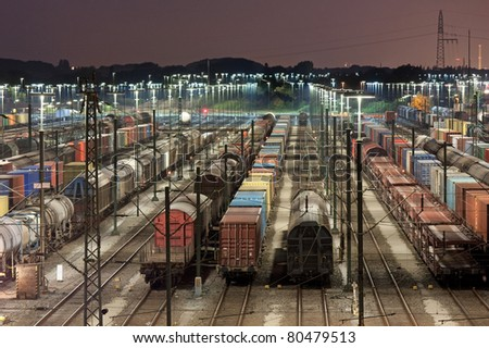 Freight train station at night in Maschen near Hamburg, it is the biggest marshalling yard in Europe. - stock photo