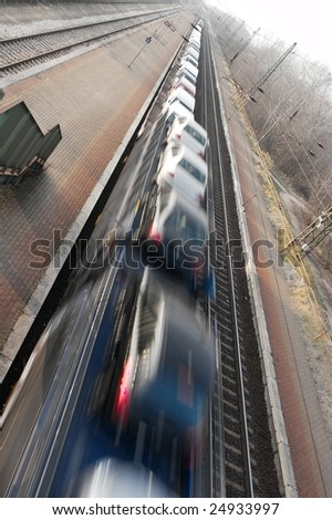 Freight train transporting cars with a motion blur - stock photo