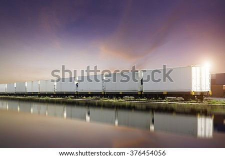 Freight trains at sunset. - stock photo