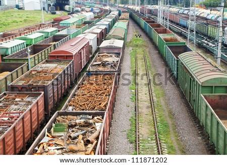 Freight trains on cargo terminal - stock photo