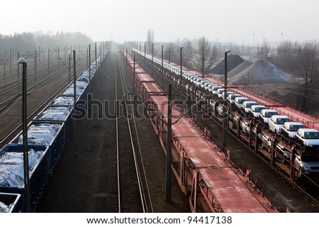 Freight trains with different cargo on the station - stock photo