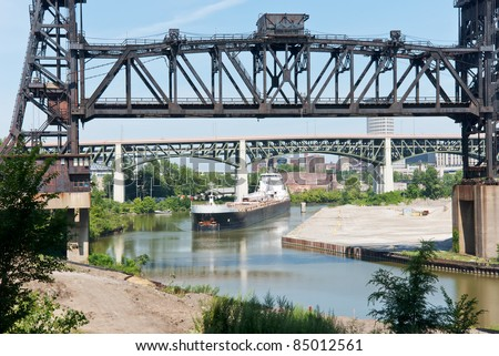 Freighter at the Drawbridge   A Great Lakes freighter sails under a railroad drawbridge as it navigates the winding Cuyahoga River in Cleveland, Ohio