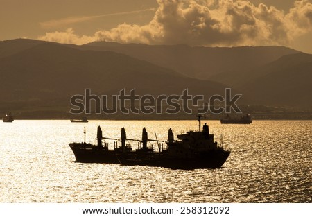 Freighter ship at anchor in Algecrias Bay with the Spanish coastline to the rear seen from The Rock, Gibraltar, United Kingdom, Western Europe. - stock photo