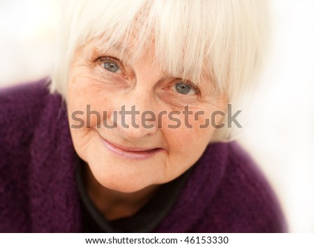 Freindly older mature woman on white background  - looking up at your - stock photo