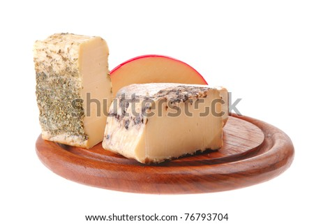 french aged cheeses served on wooden plate