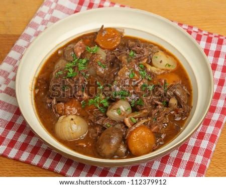 French beef bourguignon stew with lardons,  shallots, mushrooms and carrots. - stock photo