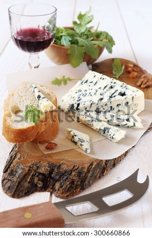 French blue cheese Roquefort and glass of red wine - stock photo